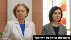 MOLDOVA -- (R-L) Moldovan Prime Minister Maia Sandu, Parliament Speaker Zinaida Greceanii and President Igor Dodon, who was temporarily relieved of his duties by a Moldovan court to allow a stand-in to call a snap election, attend new ministers' swearing-