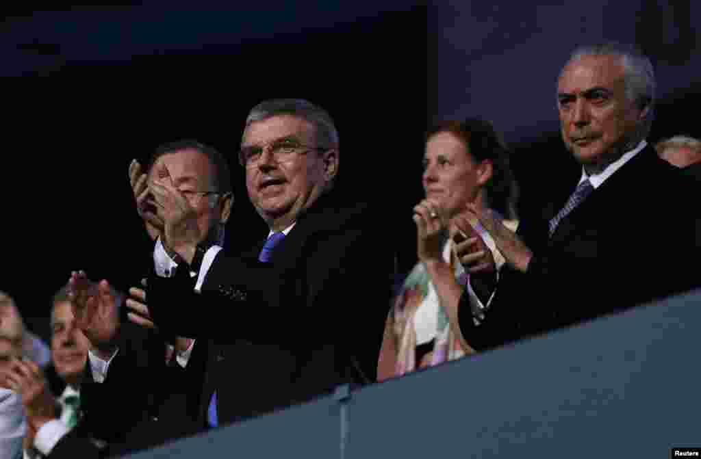 The president of the International Olympic Committee, Thomas Bach (center), and Brazil's interim president, Michel Temer, watch the festivities.