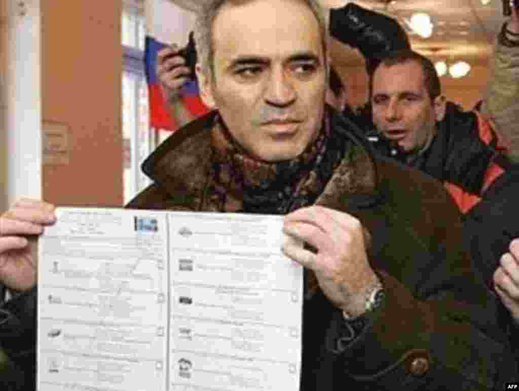 "Opposition leader Garry Kasparov displays his ballot, on which he has drawn large ""X""s as a sign of protest. Last week, Kasparov served a five-day detention that officials say was imposed after he violated Russian laws on demonstrations during an opposition rally."