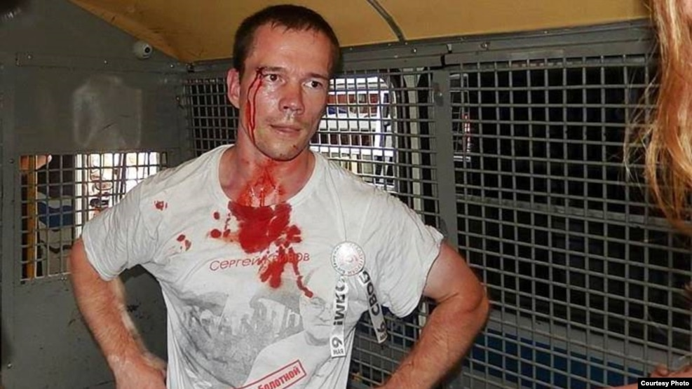 Ildar Dadin is serving 2 1/2 years for repeatedly holding unsanctioned demonstrations. This picture shows him in August 2014 after he was arrested by Moscow police during protests.