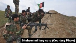 Afghan soldiers take part in a military operation in the Sanchark district of Sar-e Pul Province earlier this month.