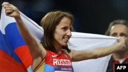 Russian runner Maria Savinova-Farnosova celebrates after winning the women's 800-meter final at the London 2012 Olympic Games in August 2012.