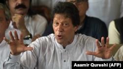 FILE: Imran Khan gestures as he addresses members of the media in July, 2017.