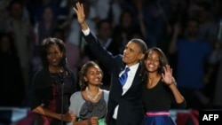 U.S. -- President Barack Obama walks on stage with first lady Michelle Obama and daughters Sasha and Malia to deliver his victory speech on election night in Chicago, 07Nov2012