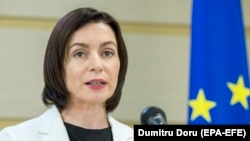 Moldovan Prime Minister Maia Sandu speaks during a briefing in Chisinau on June 13.