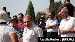 Ռաուֆ Միրկադիրովը մասնակցում է հոր հուղարկավորությանը, Բաքու, 24-ը մայիսի, 2014թ.։