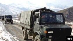 نیروهای ترکیه در حال عقب نشینی از شمال عراق. عکس از: EPA