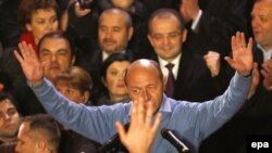 Incumbent President Traian Basescu reacts after first exit-poll results were made public at Liberal Democratic party headquarters in Bucharest late on December 6.