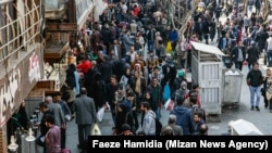 Iran -- Crowd of people in a street in Tehran. FILE PHOTO