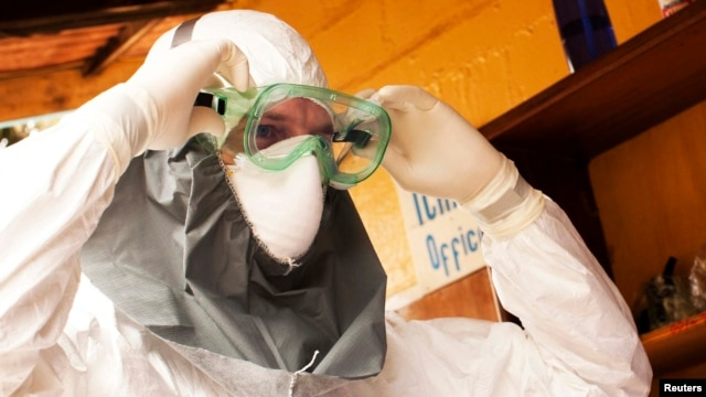 Dr. Kent Brantly wears protective gear at the case management center on the campus of ELWA Hospital in Monrovia, Liberia, in this undated handout photograph.