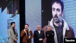 Homayoun Ghanizadeh speaking during a film award ceremony in Tehran, January 30, 2020