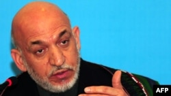 Afghan President Hamid Karzai speaks to the media at a press conference in Istanbul.