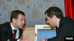 Surkov (right) huddling with Medvedev back when the latter was just a lowly first deputy prime minister.
