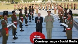 Afghan President Ashraf Ghani (left) and Pakistani army chief General Raheel Sharif offering prayers at a Pakistani war memorial in Islamabad on November 14.