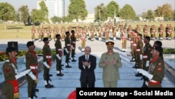 FILE: Afghan President Ashraf Ghani and former Pakistani army chief General Raheel Sharif offering prayers at a Pakistani war memorial in November 2014.