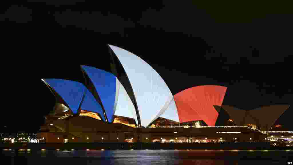 Australia -- The Sydney Opera House is illuminated in the French national colours in tribute for the victims of the 13 November Paris attacks, in Sydney, Australia, 14 November 2015.