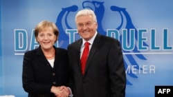 German Chancellor Angela Merkel (CDU) and Social Democratic Party (SPD) leader and Foreign Minister Frank-Walter Steinmeier prior to the fourth-ever televised German election debate, in Berlin on September 13.