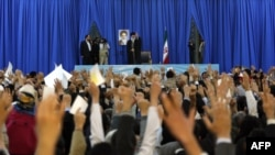 Iranian Supreme Leader Ayatollah Ali Khamenei waves to the crowd before addressing thousands of people for Norouz in the the holy city of Mashhad on March 21.