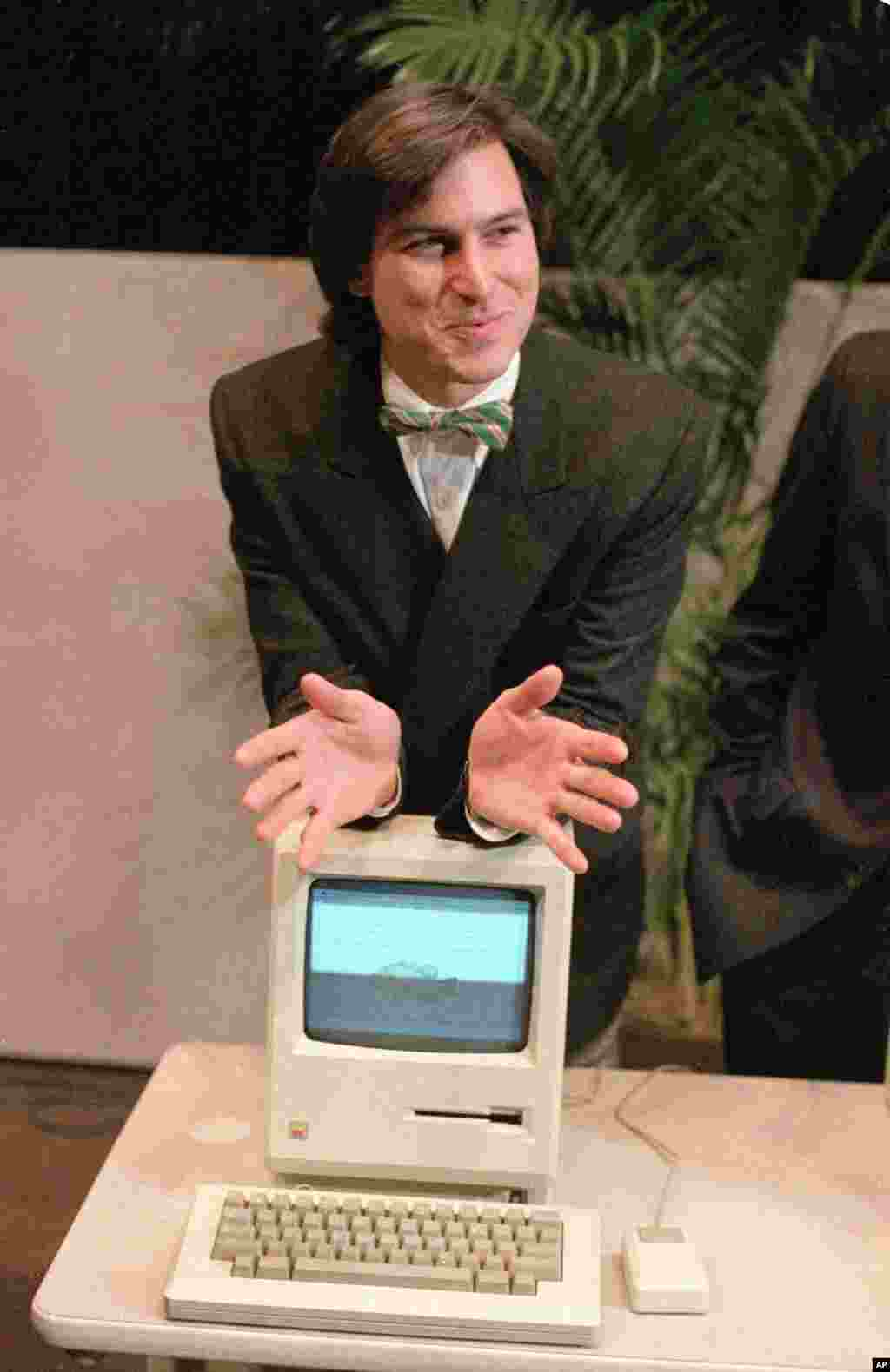 Steve Jobs, chairman of the board of Apple Computer, leaning on a new Macintosh personal computer following a shareholder's meeting January 24, 1984 in Cupertino, California. The Macintosh was initially priced at $2,495.