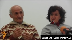 Armenia - Stepan Sularian and his wife Vartine, refugees from the Syrian-Armenian town of Kessab, speak to journalists in Yerevan, 3Apr2014.