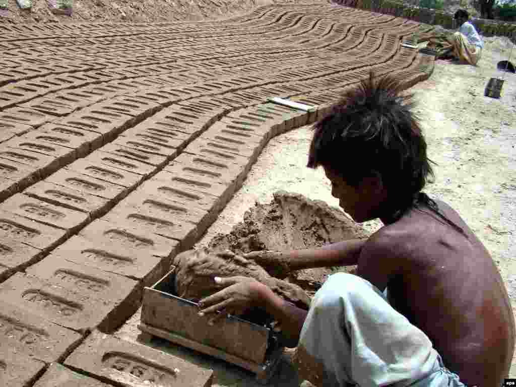 A boy work at a brick kiln on the outskirts of the Pakistani city of Hyderabad.