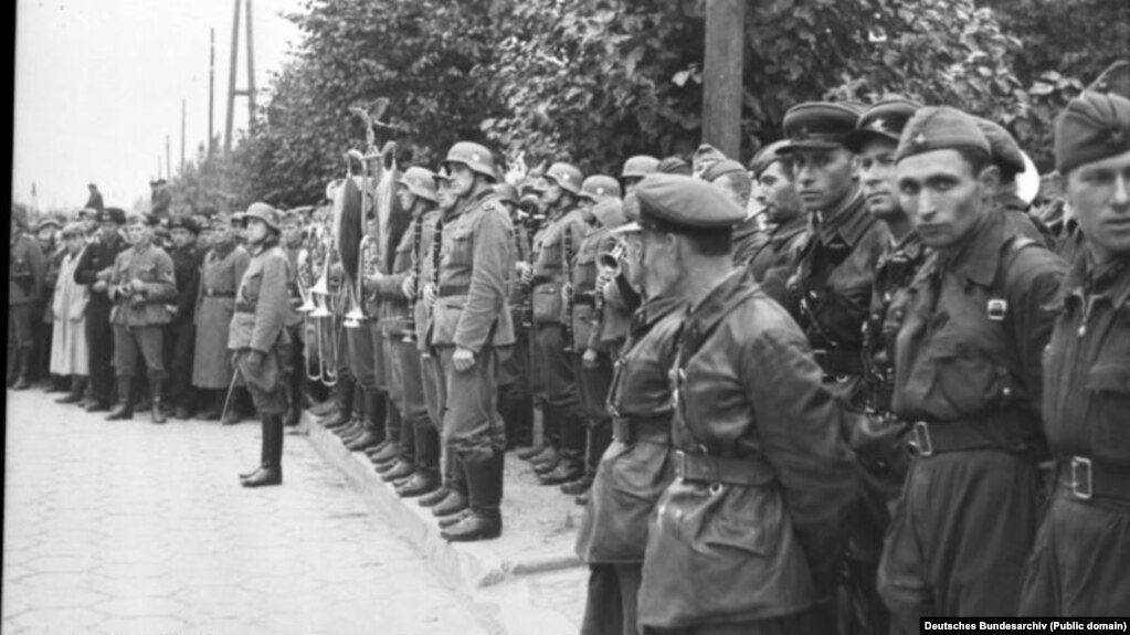 German and Red Army soldiers attend parade in Brest following the invasion of Poland in September 1939.