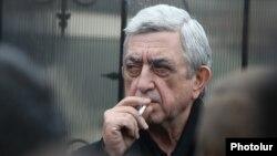 Szerzs Szárkiszján korábbi elnök Georgij Kutoján nemzetbiztonsági igazgató temetésén, 2020. január 20-án.