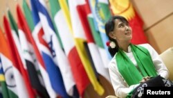 Aung San Suu Kyi waits before she delivers a speech during the last day of the 101st session of the International Labor Conference of the ILO in Geneva on June 14.