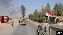 Iraqi troops deploy in the town of Shirqat, around 80 kilometers south of Mosul, on September 22.