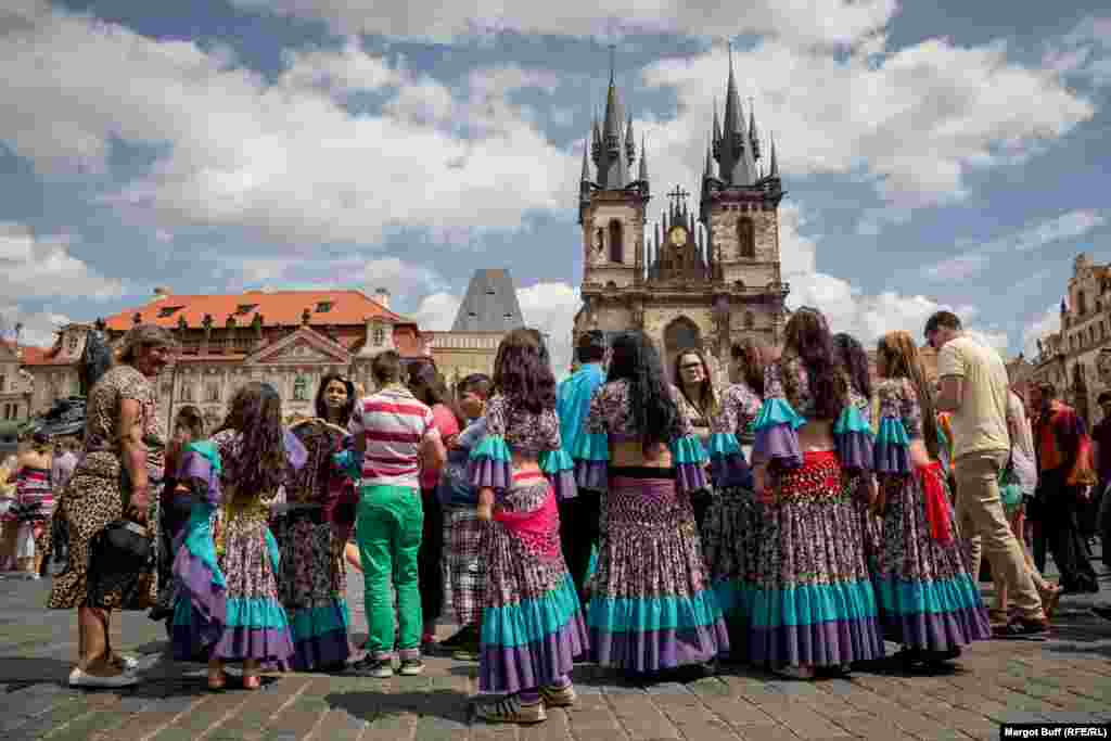 Dancers gather on Prague's Old Town Square.