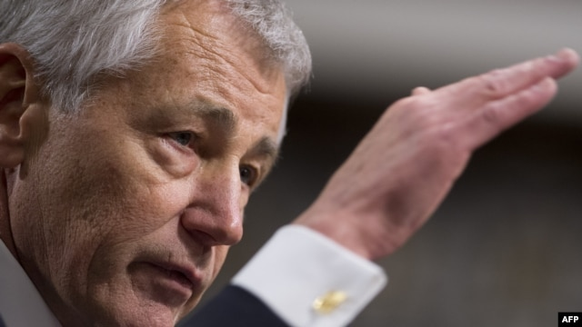 Former U.S. Senator Chuck Hagel was approved by the slimmest margin ever to pass a nominee for the post of defense secretary.