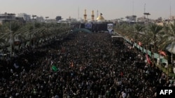 Iraqi Shi'ite Muslim pilgrims gather during the Arbaeen religious festival in Karbala on December 13.