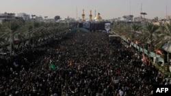 Iraqi Shi'ite Muslim pilgrims gather during the Arbaeen religious festival in Karbala on December 13.