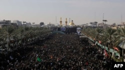 Iraqi Shi'ite Muslim pilgrims gather during the Arbain religious festival, between the Imam Hussein and Imam Abbas shrine 80 kilometers south of Baghdad in December 2014.