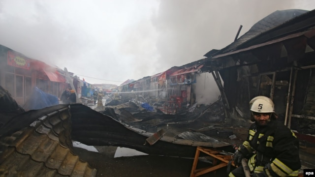 Firefighters work at a marketplace, which was set on fire after a terrorist attack in Grozny on December 4.