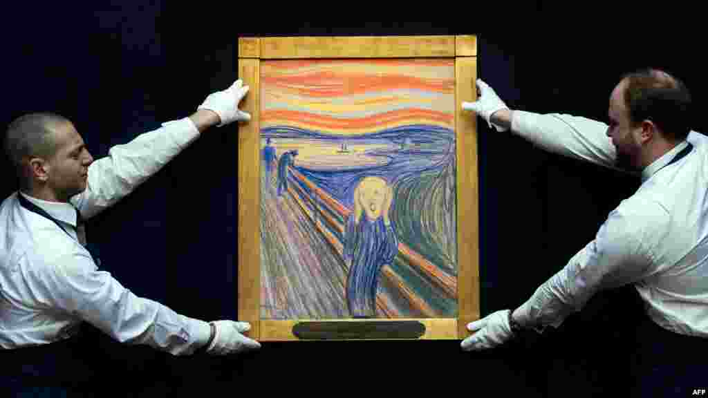 "Sotheby's employees pose with Norwegian artist Edvard Munch's 1895 pastel-on-board version of ""The Scream,"" which went up for auction in London on May 2."