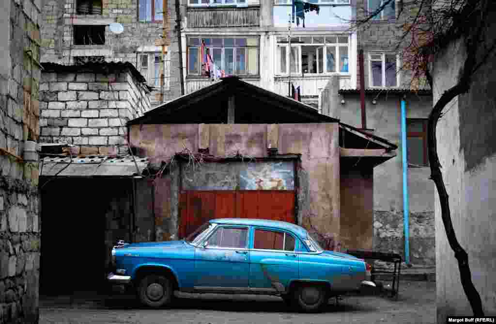 A Soviet-era Volga car in an alley in Stepanakert