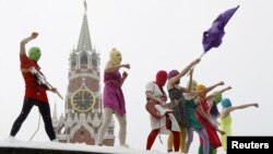 Members of the feminist punk rock group Pussy Riot performing an unsanctioned concert on Red Square