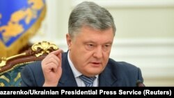 Ukrainian President Petro Poroshenko made the announcement at a meeting of the National Security and Defense Council in Kyiv on December 26.