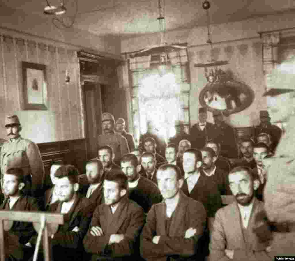 The trial of the assassination conspirators in Sarajevo, October, 1914. Princip is seated in the center of the first row.