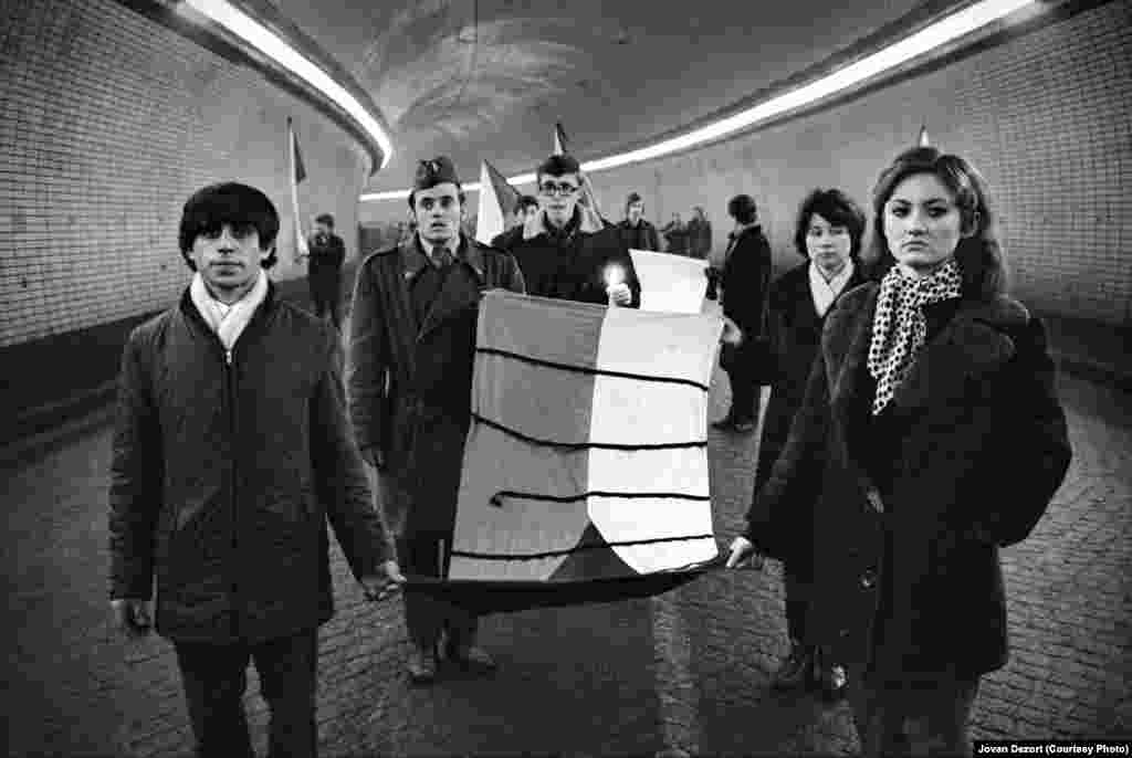 People carry Czechoslovak flags during Palach's funeral on January 25, 1969.
