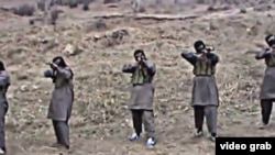 Tajik militants appear in a video purportedly training in Pakistan, where Jamaat Ansarullah was founded in 2006 by former members of the Islamic Movement of Uzbekistan (IMU).