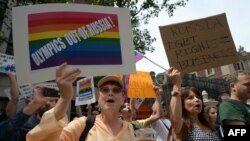 Protesters hold a demonstration against Russian antigay legislation and against the Russian president's stand on gay rights in front of the Russian Consulate in New York on July 31.