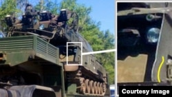 Bellingcat investigators say they have identified some unique characteristics of the Russian Buk M1 self-propelled missile launcher (pictured), which was photographed in separatist-controlled eastern Ukraine at the same time as when Flight MH17 was shot down.