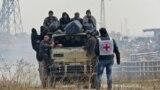 Aleppo, ewakuasiýa edilýän siriýalylar. 16-njy dekabr, 2016.