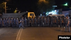 Armenia - Riot police block a street leading to a police station in Yerevan seized by opposition gunmen, 18Jul2016.