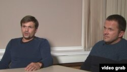Two men carrying passports with the names Ruslan Boshirov (right) and Aleksandr Petrov are among those who have been hit with sanctions. (file photo)