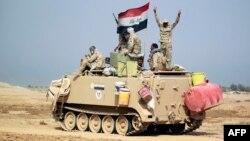 قوات عراقية في جرف الصخر