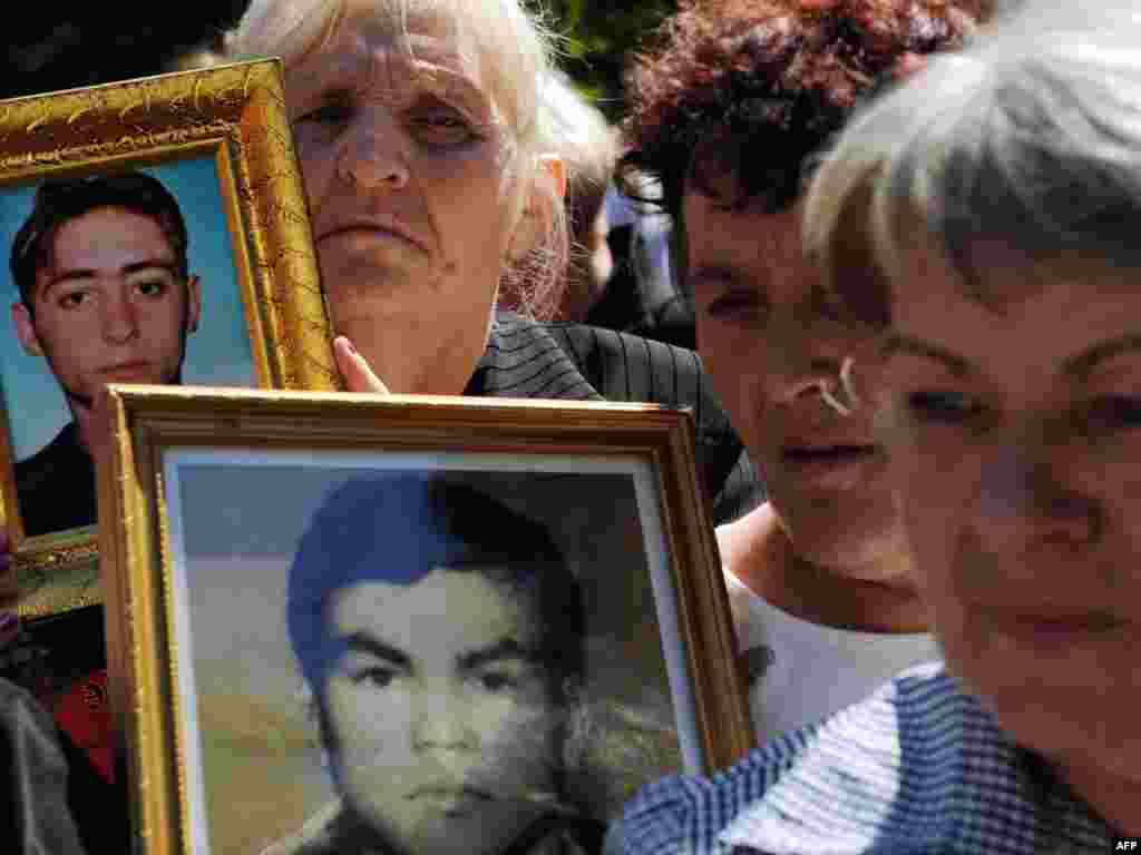 Serbian women hold pictures of their missing relatives during a commemoration in Belgrade on August 30. Some 14,650 people are unaccounted for after the wars in Croatia, Bosnia-Herzegovina, and Kosovo, which tore apart the former Yugoslavia in the 1990s. Photo by Alexa Stankovic for AFP