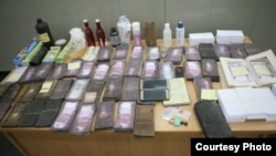 Police also seized materials capable of being used for counterfeiting, a French resident permit, and two Cameroonian passports.